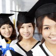 Happy graduation asian girls — Stock Photo