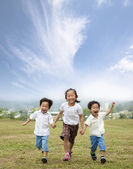 Happy running asian kids — Stock Photo