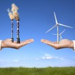Pollution and clean energy concept. businessman holding windmills and refin — Stock Photo