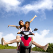 Happy young woman having summer trip on a scooter — Stock Photo #6403927