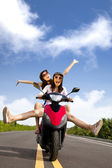 Happy young woman having summer trip on a scooter — Stock Photo