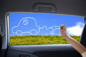 Hand drawing Electric car concept on the car windows — Stock Photo
