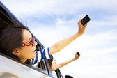 Young woman holding camera and mobile phone taking photos — Foto Stock