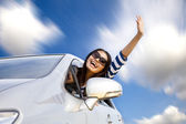 Happy young woman in car driving on the road — Foto Stock