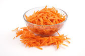 Grated carrots in a glass cup — Stock Photo