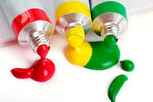 Red, yellow and green colors in tubes — Stock Photo