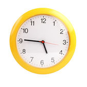 Yellow, round the clock on a white background — Stock Photo