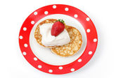 Fritters with sour cream and a strawberry — Stock Photo