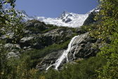 Snowy peaks, Mount Herzog ,Alibeksky Falls — Stock Photo
