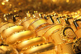 Gold jewelry background / soft selective focus — Stock Photo
