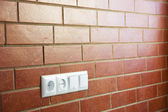 Power outlets on the brick wall / horizontal / photo — 图库照片