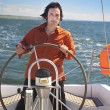 Young Man is Sailboat Captain - Stock Photo