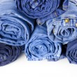Rolls of Blue Jeans isolated on white background — Foto Stock