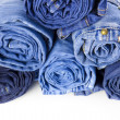 Rolls of Blue Jeans isolated on white background — 图库照片