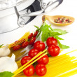 Italian cooking / pasta, tomatoes, basil, garlic and saucepan — Stock Photo