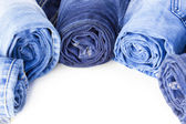 Rolls of Blue Jeans isolated on white background — Stock Photo