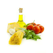 Ingredients for Italian cooking: basil, tomato, parmesan, garlic — Stock Photo