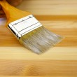 Wood texture, human hand and paintbrush / housework background — Stock Photo