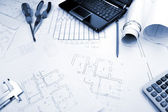 Blueprints background with computer and tools / blue toned — Stock Photo