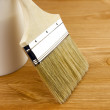 Wood texture, can and paintbrush / housework — Stock Photo