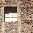 Royalty-Free Stock Photo: Stone wall with window