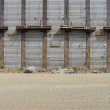Stock Photo: Concrete wall and sand road on large construction site
