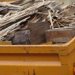 Stock Photo: Metal orange container filled with wood timber rubble