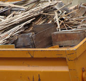 Metal orange container filled with wood timber rubble — Stock Photo