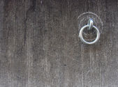 Metal ring attached to a stone grunge wall — Stock Photo