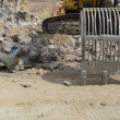 Excavator and demolition rubble on industrial construction si — Stock Photo #6087773