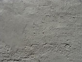 Gray painted worn brick and concrete wall — Stock Photo