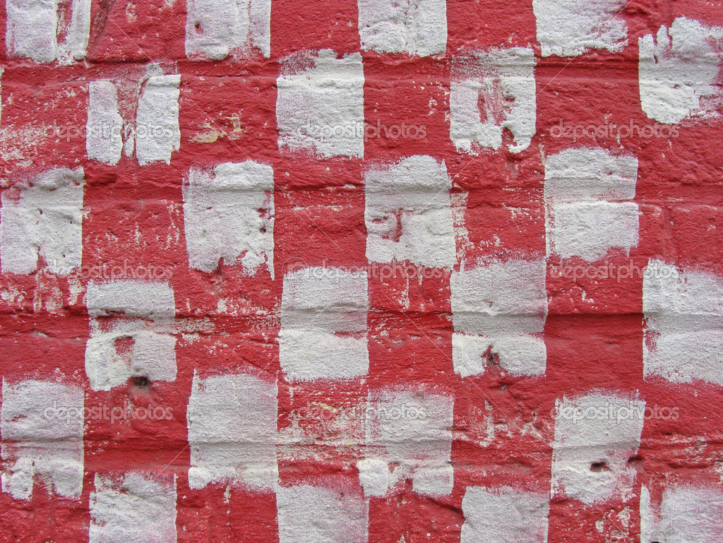 White And Red Paint Checker Pattern On Brick Wall Stock