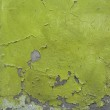 Green blathering chipping paint on grunge concrete wall — Stock Photo #6302161