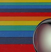 3d render silver techno ball in front of a rainbow colored backg — Stock Photo