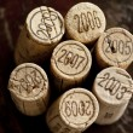 Bordeaux red wine bottle corks — Stock Photo