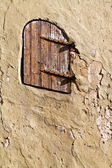 Door on the wall of the historical storehouse. — Stock Photo