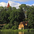 Church in Talsi city and old house. — Stock Photo