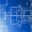 Stock Photo: Sample of architectural blueprints over a blue background