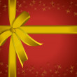 Beautiful red paper and golden ribbon present. — Stock Photo