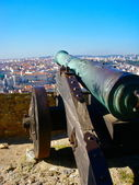 Lisbon rooftop view from old castle with cannon — Stock Photo