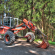 Tractor in forest - Stock Photo