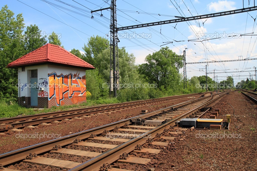 Railroad with building with graffiti. — Stock Photo #5691679