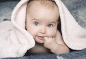 Baby with a towel — Stock Photo