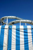 Roller coaster and blue lines — Stock Photo