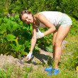 Young Woman With Hoe - Lizenzfreies Foto