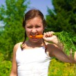 Woman eating Carrot — Stock Photo