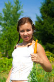 Woman Holding Carrot — Stock Photo