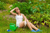 Young woman in kitchen-garden — Stock Photo