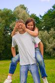 Girl closing her boyfriend eyes by hands — Stock Photo