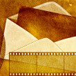 Envelope on vintage grunge photographic background — Stock Photo